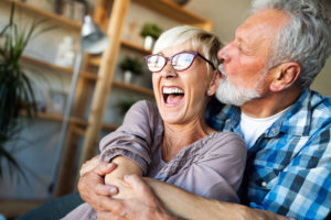 Senior couple hugging and kissing