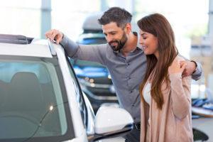 Woman and man looking at car