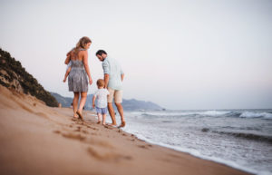 Woman and man at beach with two children
